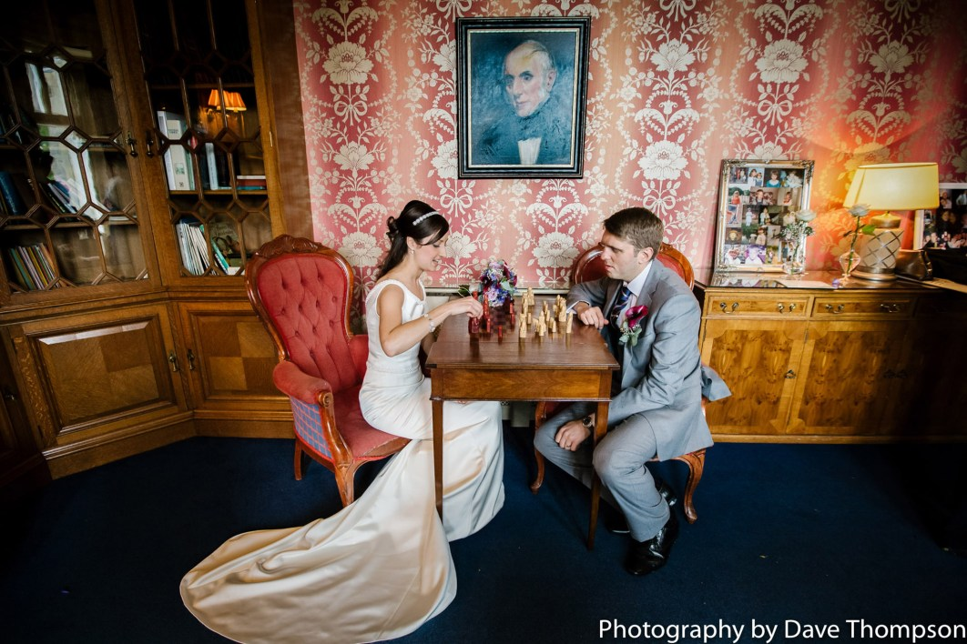 The bride and groom playing chess