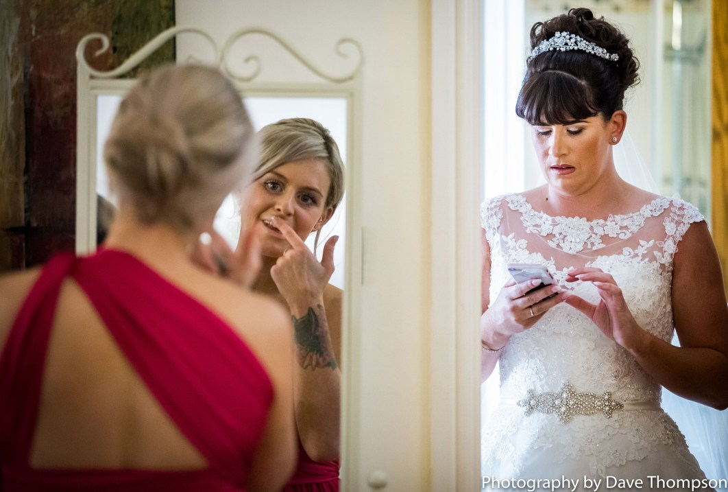 Bride on her phone before the wedding