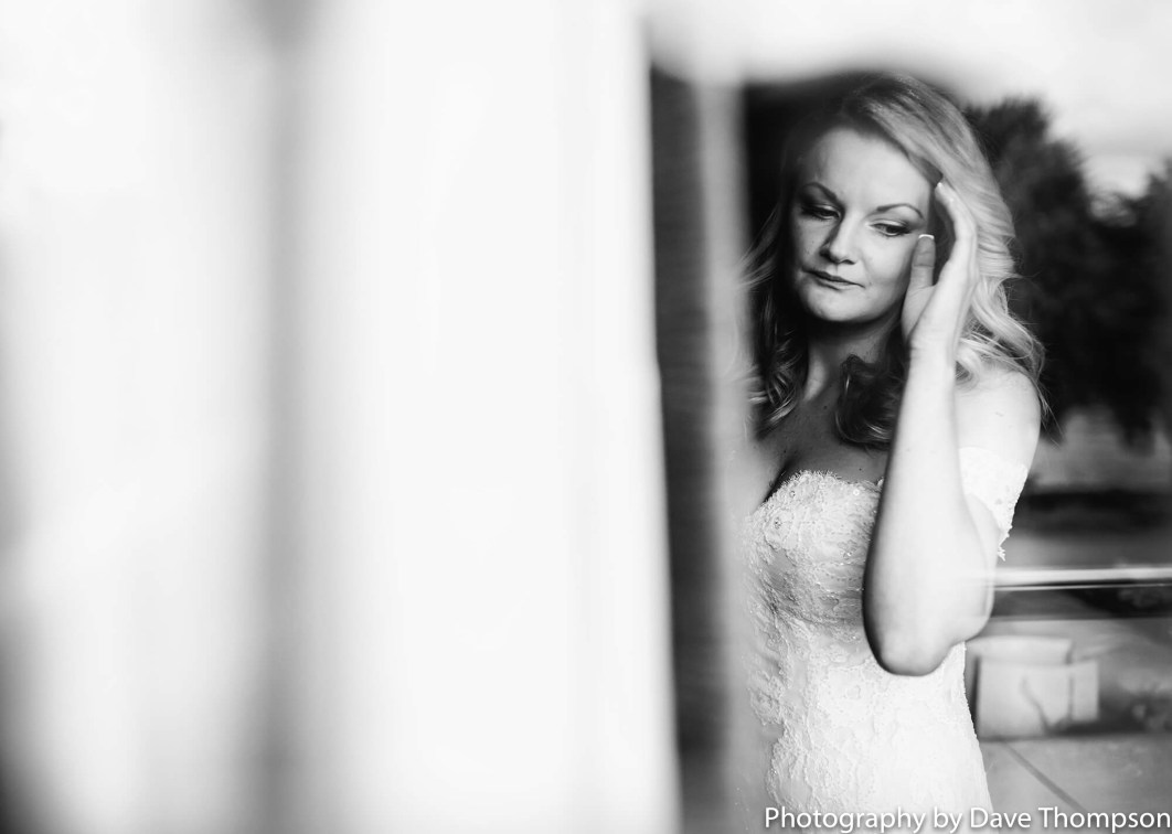 The bride has a quiet moment before seeing her father