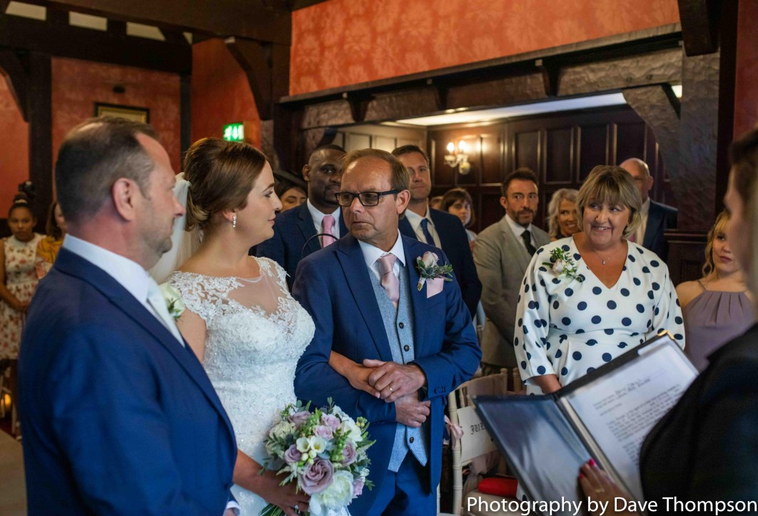 The bride is given away