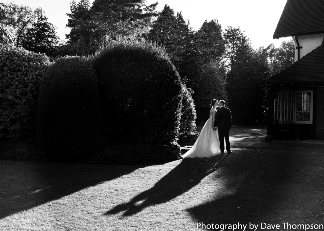 Black and White bride and groom portrait with shadows cast from the sun