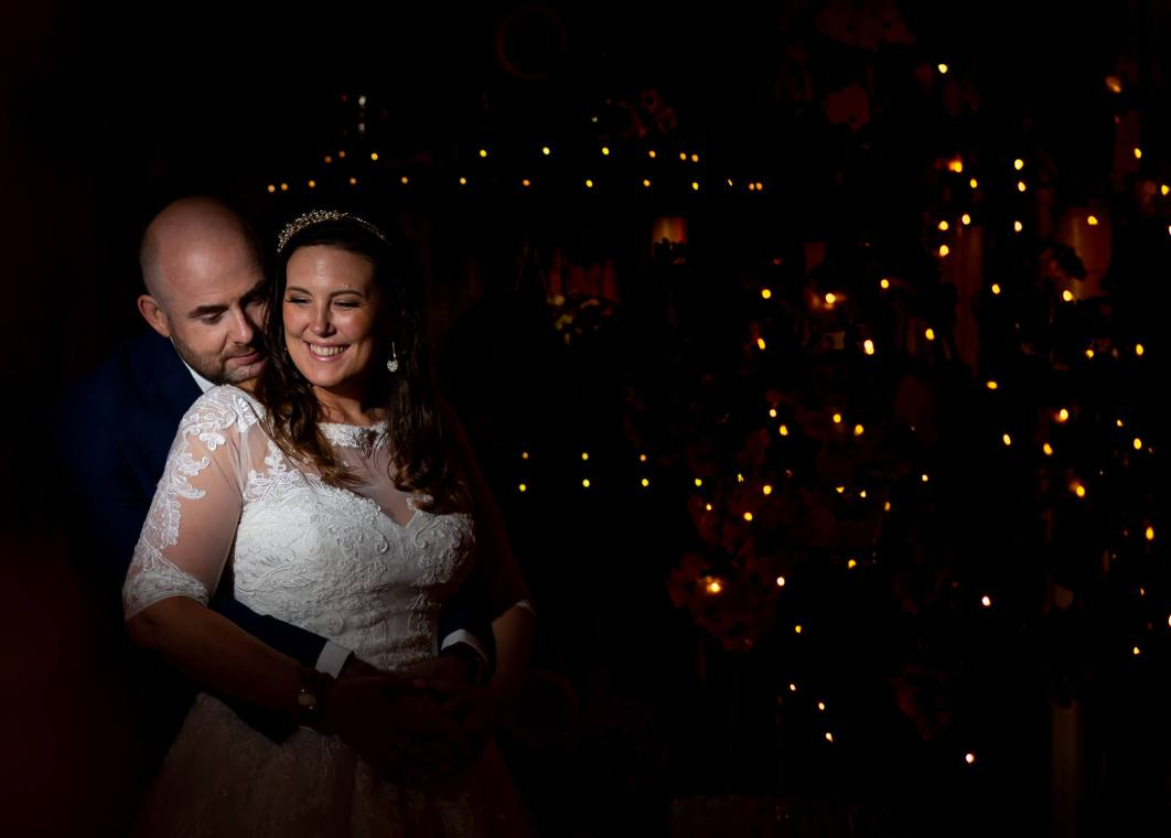 An off camera flash portrait with the bride and groom