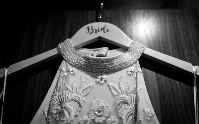 A brides dress hands from a wardrobe door