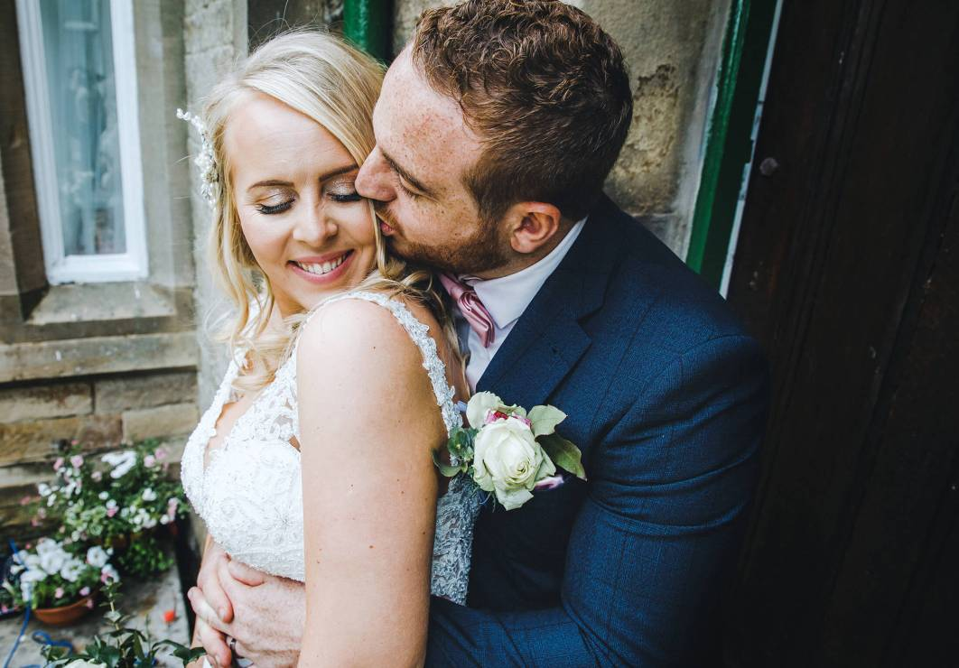 A kiss between the bride and groom