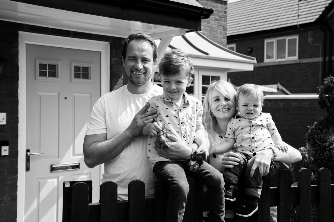 A family of four pose for a doorstep photograph during the Covid-19 pandemic.