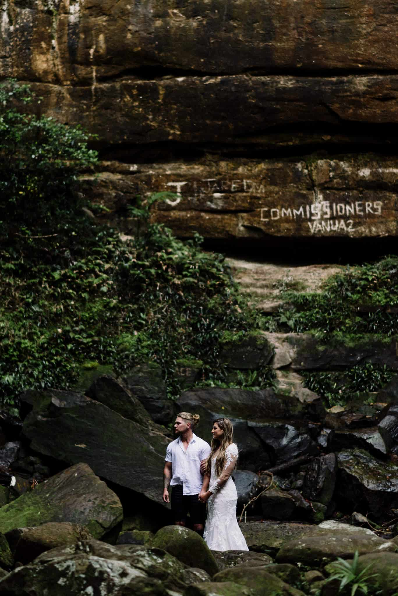 Stunning bride and groom eloping in Pine forest, down by waterfall in Gap Creek near Newcastle
