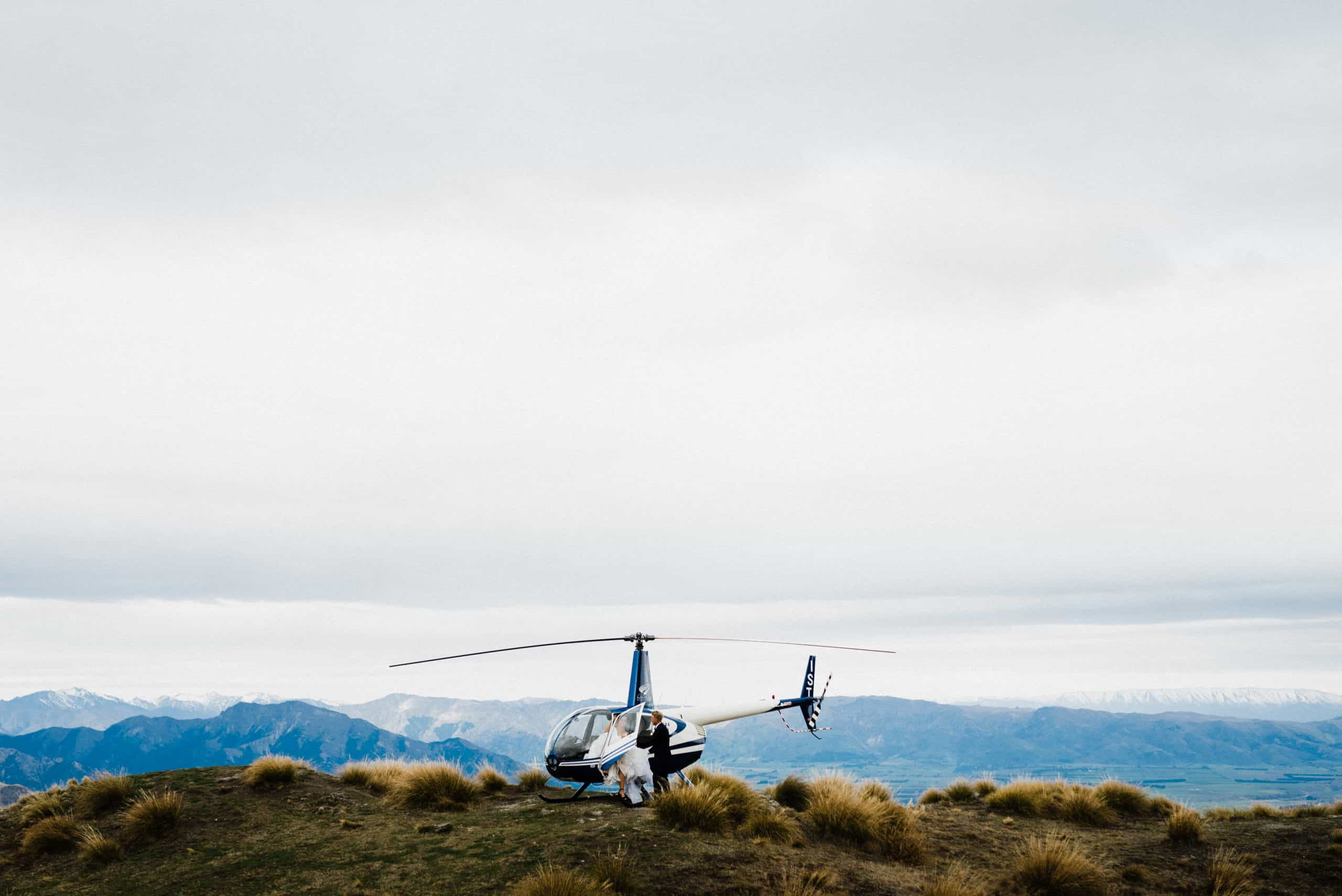 helicopter landing on top mountain elopement in new zealand
