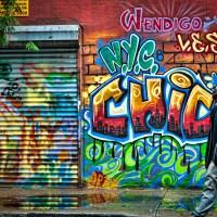 Graffiti Reflection on the Sidewalk