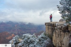 Standing on the Edge of Grand Canyon for winter couples portrait
