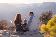 The family looking off at the Grand Canyon Sunset