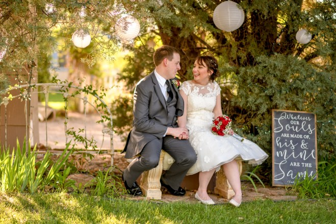 Trent and Christy on a bench at Off the Beaten Path Wedding Venue