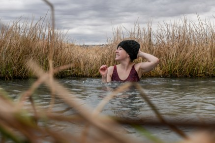 Adventure Photographer in a natural hot spring
