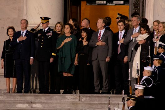 Family members, including George Walker Bush, the 43rd President of the United States, look on as GEORGE HERBERT WALKER BUSH, the 41st President of the United States, look on as his body is brought to the Capitol Rotunda for a State Funeral, December 3, 2018