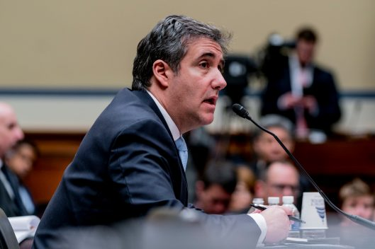 President DONALD TRUMP's former personal attorney, MICHAEL COHEN, testifying before the House Oversight Committee, February 27, 2019