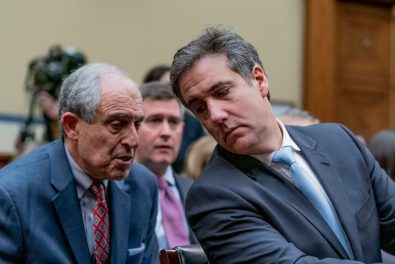MICHAEL COHEN speaks with his personal attorney, LANNY DAVIS, as COHEN testifies before the House Oversight Committee, February 27, 2019