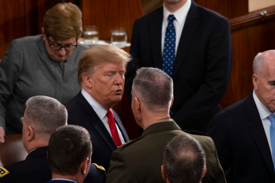 President DONALD TRUMP greets lawmakers after he completes his State of the Union address, February 5, 2019