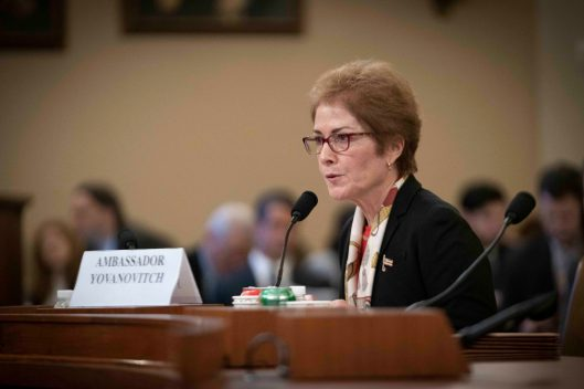 "MARIE YOVANOVITCH, former United States Ambassador to Ukraine, testifies before the House Intelligence Committee, after she was reportedly pushed out of her position by President Donald Trump. The call summary between President Trump and Ukrainian President Volodymyr Zelensky said that Trump called her ""bad news"". In response, YOVANOVITCH ""shocked"" and ""devastated"" at the President's characterization of her. November 15, 2019"