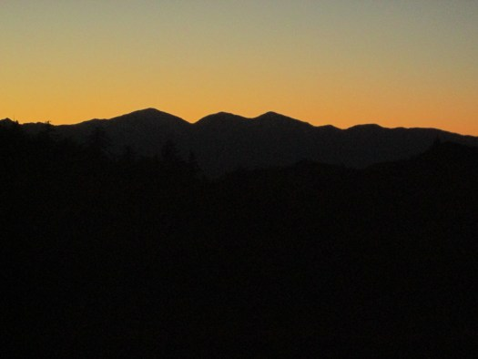 The orange sky in the mountains at sunset.