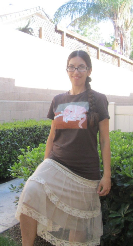 Wearing the Lady dog shirt with a lacy tan colored skirt.