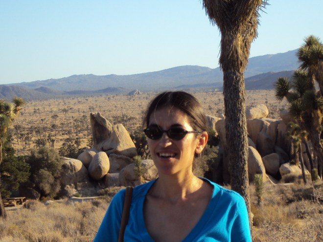 A Joshua tree is directly behind me.