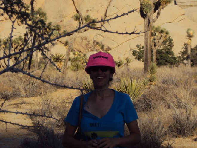 Posing for the camera with the Joshua trees in the background.