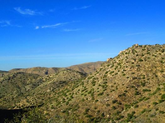 Chaparral and boulders dot the landscape.