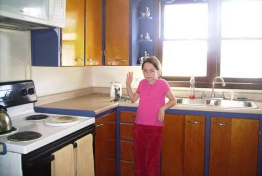 Orchard House has a fully functional kitchen with a stove, microwave, sink, and cabinets.