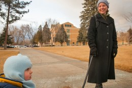 "English professor Jessica Winston, right, and son, Robert, enjoy a liesurly stroll and wagon ride across Idaho State University's lower campus, Thursday, Jan. 30, 2014, in Pocatello, Idaho. Winston, who specializes in early modern literature and directs ISU's graduate studies in English, exclaimed she ""felt like a celebrity with paparazzi following"" when she encountered several photo media students working on their class assignment. (ISU Photo/Terry Ownby)"