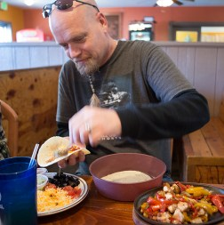 Ed Ritterbush, a photography student at Idaho State University, finally gets to savor his sizzling fajitas in Lava Hot Springs, Idaho.