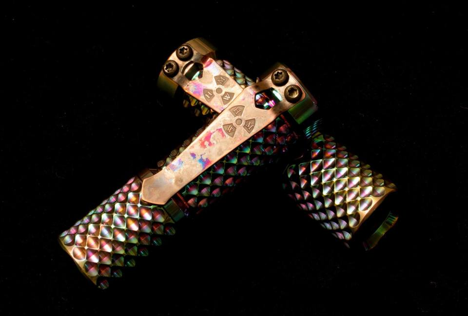 Hanko machine Works custom flashlight in titanium with  prisim finishing in Reactor pattern