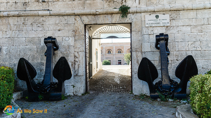 Open doorway to Forte Michelangelo, ship anchors on each side and view to inner courtyard