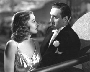 Ellen Drew and Basil Rathbone