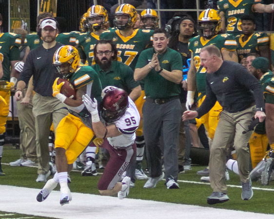 NDSU RB #8 Bruce Anderson runs 32 yards before he's chased out-of-bounds by OLB #95 John Steffen with 10:16 left in the 1st Quarter. NDSU Running Game Coordinator-Offensive Line, Conor Riley (white hat); NDSU Assistant Strength and Conditioning Coach, Zach Cahill (with beard); and NDSU Head Coach, Chris Klieman (yelling) on the sidelines; watching the play. It was Second and 4 at the NDSU 10. -<small>Photo DSC06117 by Craig Maas</small>