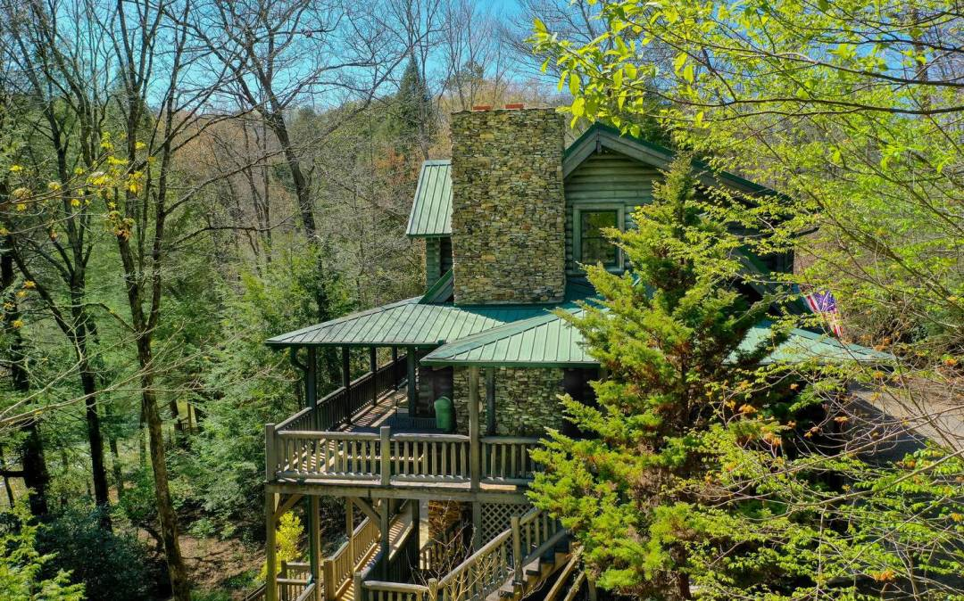 Sitting just above the glistening rushing waters of Fightingtown Creek, this majestic Cypress Log Home w/wide covered porches spanning 3 sides, welcomes all who venture into it's natural private setting of evergreen hemlocks, native ferns & flowering rhododendrons.The 1 acre lot flows gently from the home to a level, widespread backyard bordering 200 ft of creek frontage laden w/natural Trout and a nicely set firepit area. A few of the 3 BR/2 BA log home's unique features are: Cypress log beams throughout w/a single massive Cypress tree spanning 28ft from the open great room, past the spacious loft area (accessed by custom cut cypress log steps) up to the peak of the rustic wood cathedral ceiling; 2 stacked stone masonry fireplaces, custom kitchen w/center island, extended dining area, Australian cypress wood floors, full unfin basement w/ partially finished T&G walls, stubbed for further