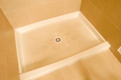 fiberglass shower pan to a tile wall