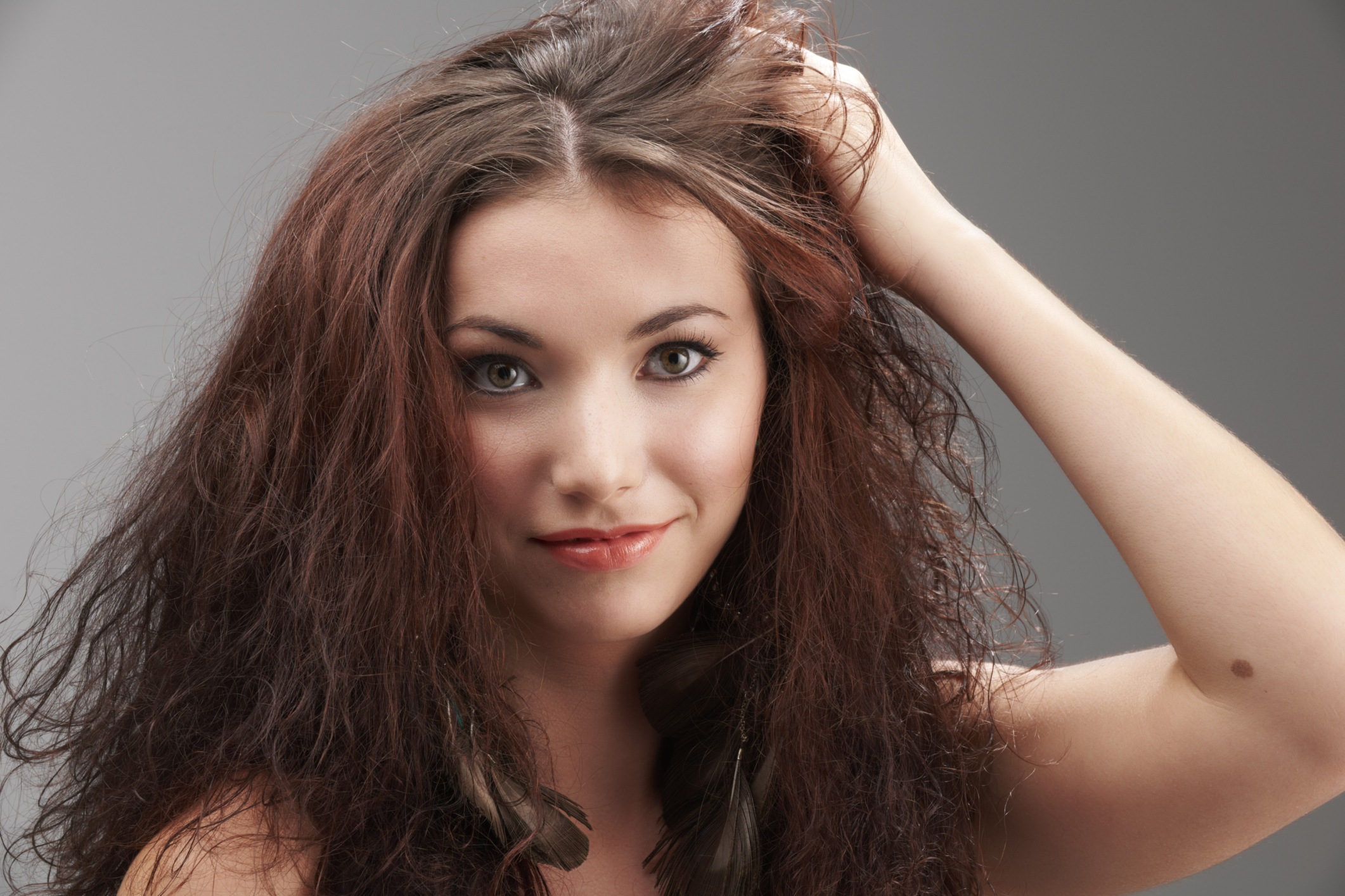 How to Tame Frizzy and Unruly Hair