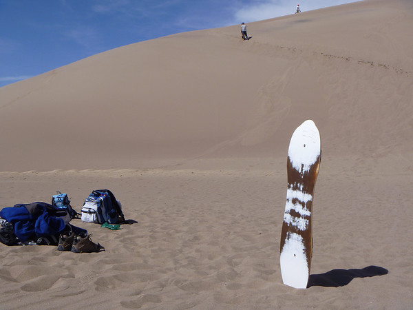 sandboarding with friends in the Great Sand Dunes