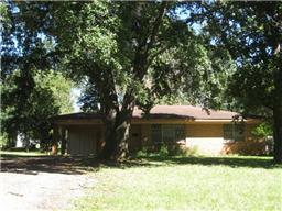 Good Condition!  This two bedroom, one bath home sits on an oversized lot in town.  It is in very good condition and the pretty yard has nice, large trees!  The home has a den and living room, nice laundry off the carport and a large storage closet in the hallway.  There is also a fenced back yard with patio.  Come see!