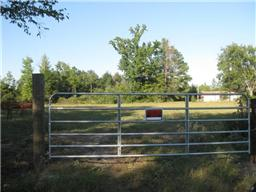 Deer Hunter's Dream!  This place in the country has scattered trees, is secluded and would make a great hunting get-a-way!  There is an older double wide mobile home on the property that would make a great place to camp.