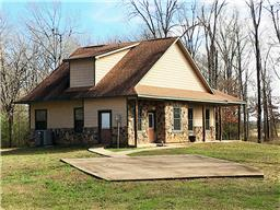 Secluded Setting!  1.5 story 3/2 hardy plank home on 10 acres is quiet yet close to Loop 304!  It is nestled among the pretty trees away from the hustle and bustle of Highway 287 South.  You will enjoy the view from the great front porch - nice country living!  The home has soaring ceilings, a unique stair case railing, a pretty fireplace and tile floors in the laundry, kitchen and baths.  Come see - this could be your new home!