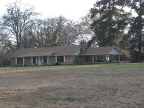 Sprawling 2 bedroom, 1.5 bathroom, brick ranch-style home, has a large living area with fireplace. The galley kitchen has lots of counter space and cabinets galore! The dining room has a sunroom out back that overlooks a pretty costal area. Two bedrooms are very spacious and share a Jack and Jill bathroom with double sinks, shower, and tub. This home has so much storage! This property would be perfect for grazing horses or cattle. Give us a call today to view this great property - it has so much to offer!