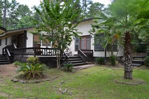 Come see this three bedroom, two bath home that sits on two interior lots! It is conveniently located across the street from the private boat ramp for Lake Forest Estates residents. It has an open kitchen, dining, and living area with a fireplace and high ceilings. There is a large game room just off the living area. The home has carpet and vinyl flooring. Outdoors, the carport has a large storage room with room for a freezer, washer and dryer, and a bonus shower. The nice deck can be accessed from the living room and game room. Give us a call to see today!