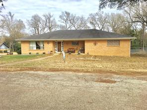 BEAUTIFUL, UPDATED HOME!  This 2 bedroom, 2 bath brick home has been completely remodeled. The kitchen and living area have an open concept for very comfortable living. This home has a large basement with full bathroom. The basement is wired for phone, cable, and internet.  There is also a great bonus room that can be used as another bedroom or a study. The updates to this home include: new paint,  new vinyl flooring, new kitchen appliances, new sinks and toilets, and updated wiring. You will love the large fenced in back yard and quiet neighborhood. There is a carport and storage shed in the backyard. This home is a must see! Call us today.