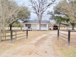 MOVE IN READY!  This two bedroom, one bath home sits on 6.76 acres just north of the Pennington community. This home has a nice covered porch, a metal carport cover, and a storage building. The living room walls have been covered with locally cut pine lumber. This home has central air and heat, new laminate flooring, and a security system with cameras. Outside you will like the 30' x 50' barn with concrete floor and the 25' x 50' shed off the side of the barn. The property has good fencing with a pipe fence and entrance across the front. The yard has live Oak and Pecan trees for shade. Come see – this could be a great full-time home or weekend get-a-way!