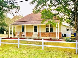 FRONT PORCH WELCOME!   This unique farm house has so much charm! From the moment you enter the front door, you will like the tall ceilings, vinyl plank flooring and bright cheerful paint colors. Large living, formal dining and handy kitchen make for good entertaining. This home has three bedrooms and two full baths. The laundry is off of the kitchen and has a nice pantry/storage area. This home has vinyl siding and central air and heat. There is a carport and an equipment shed. Hurry today to see all of this in the Lovelady ISD!
