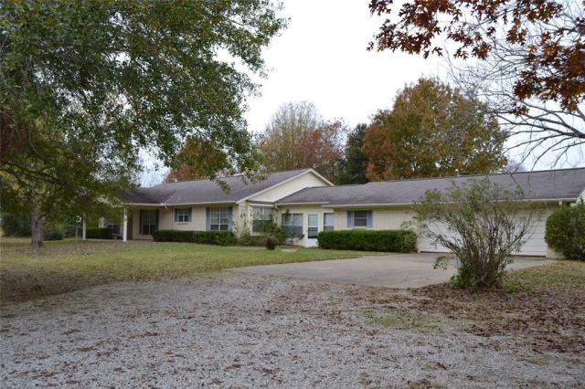 MOTIVATED SELLER!  This 3/2  brick home sits on 13.215 acres in Meadowood Subdivision. You'll love the nice size family room with coffered ceiling and fireplace. The spacious kitchen has double wall ovens, dishwasher, trash compactor, great cabinet space, & a breakfast area. For entertaining, there is a formal dining area off of the living room. The large master suite has a fireplace, its own private sitting area, & two walk-in closets. The bathroom has double vanities, a separate shower & tub.  Split plan offers two guest bedrooms that share a hall bath, making for easy family living.  There is a large room adjacent to the garage that would make a great craft/hobby room. This home is perfect for outdoor living with an enclosed patio area- perfect for that morning cup of coffee! Outside you will find a large shop with several overhead doors. There is also a small barn towards the rear of the property. This property has so much potential, you don't want to miss out!