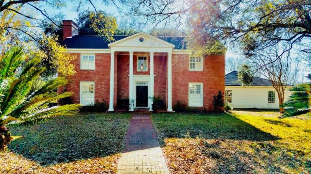 IMPRESSIVE BRICK TWO STORY COLONIAL HAS SO MUCH TO OFFER! This completely restored three bedroom, two and one half bath home is located on 6.02 acres inside the city limits of Crockett. Upon entering the impressive front door, you will be in the foyer with its lovely staircase. The large formal living room is to your left with beautiful moldings, floor length windows, and an attractive wood burning fireplace. To your right is a formal dining room for entertaining. The updated kitchen boasts all new appliances, granite counter-tops, and a spacious breakfast area. Just off the kitchen you will find a cozy den for your relaxation. This home has many extras – nice crown moldings, alarm system, spacious deck, beautiful grounds with its wonderful oaks, two car garage and unfinished private suite. Come enjoy a touch of yesteryear will all the modern amenities.