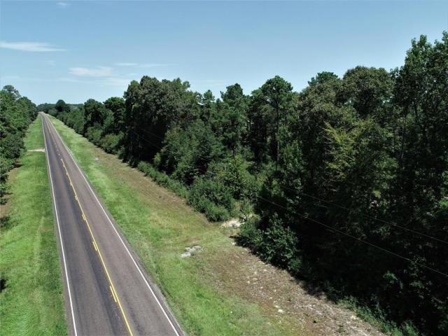PERFECT SPOT TO BUILD THAT NEW HOME!   This 30.767 acre tract has good highway frontage on 287. The property has large trees, partially fenced, and has a little roll to the terrain, making this a perfect place to build. All utilities are available at the road. Call us today to see this property!