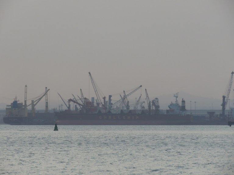 harbor cranes on the horizon