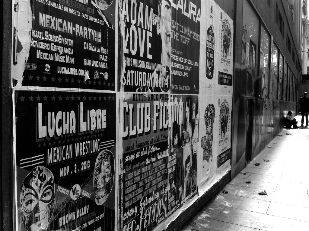 large posters on a street-side building